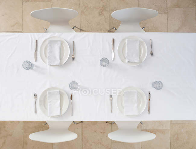 Top view of set table with tableware and cloth napkins — Stock Photo