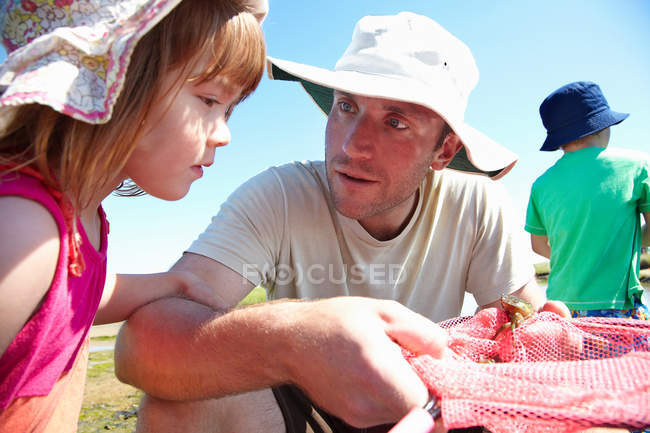 Father and daughter fishing with nets — Stock Photo