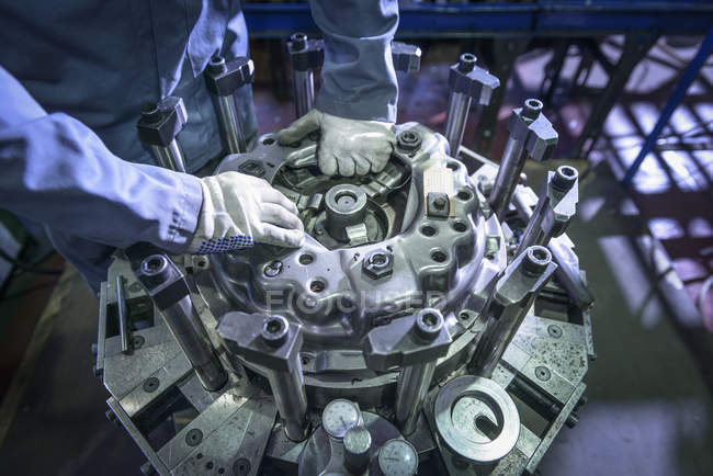 Close up of engineer assembling industrial clutch on production line — Stock Photo