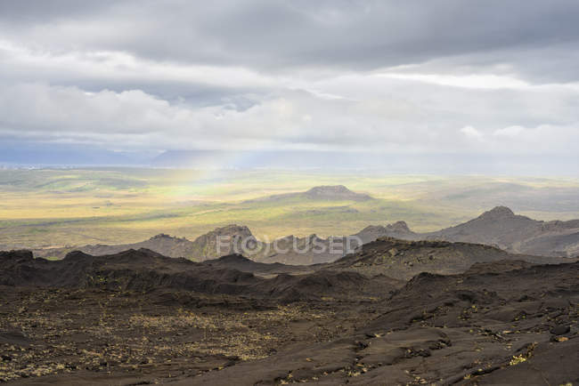 Rainbow and clouds over volcanic landscape, Helgafell, Iceland — Stock Photo
