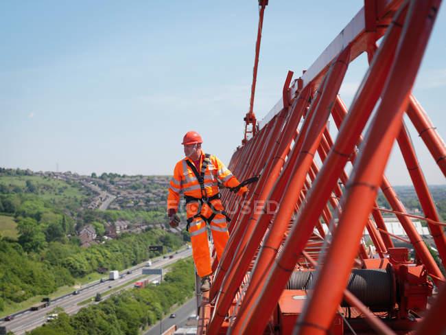 Crane Worker On Arm Of Crane — Stock Photo