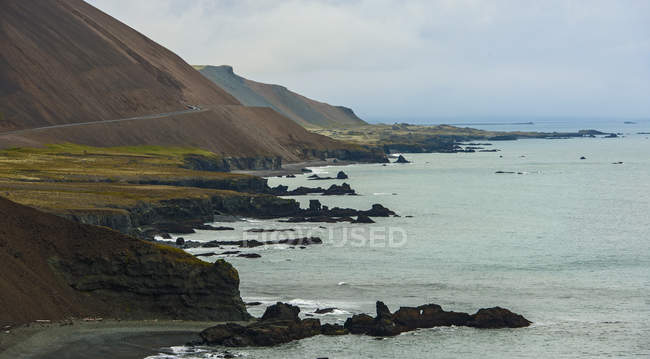 Elevated view of winding coastal road, East Iceland — Stock Photo