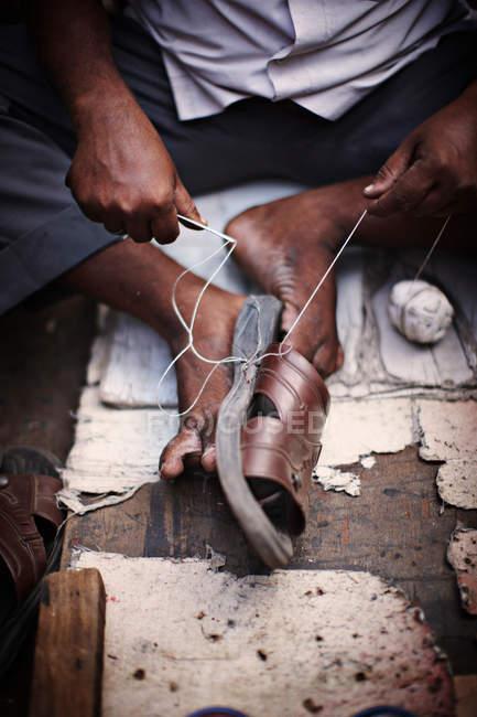 Close up of man repairing shoe — Stock Photo