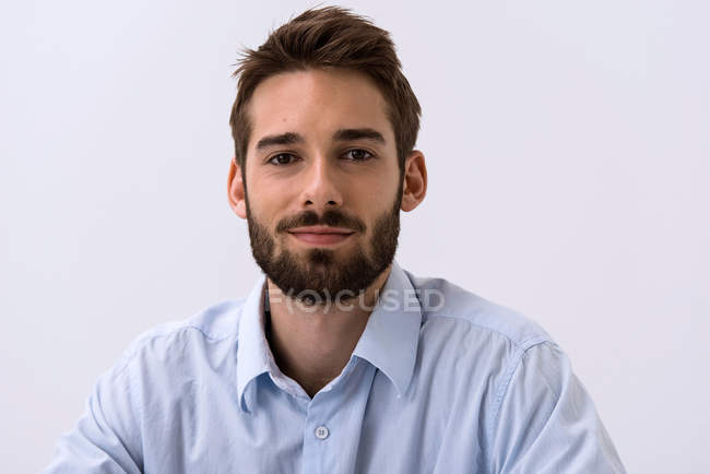 Close up portrait of young man in blue shirt — Stock Photo