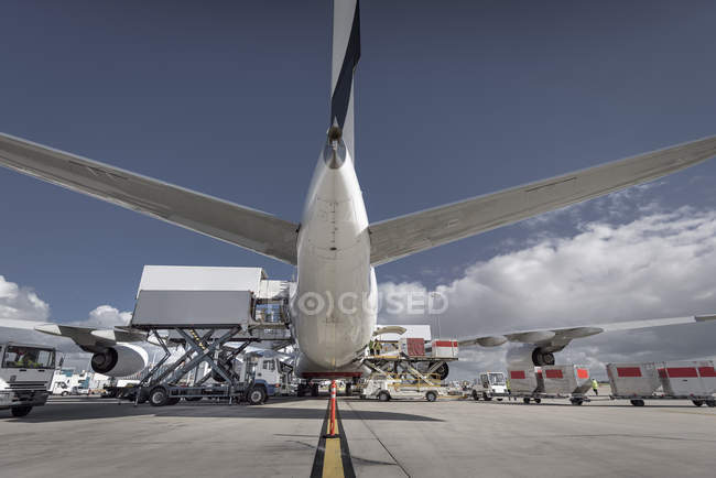 Rear view of A380 jet aircraft being loaded at airport — Stock Photo