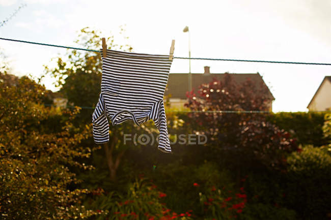 Striped top waving on clothes line — Stock Photo