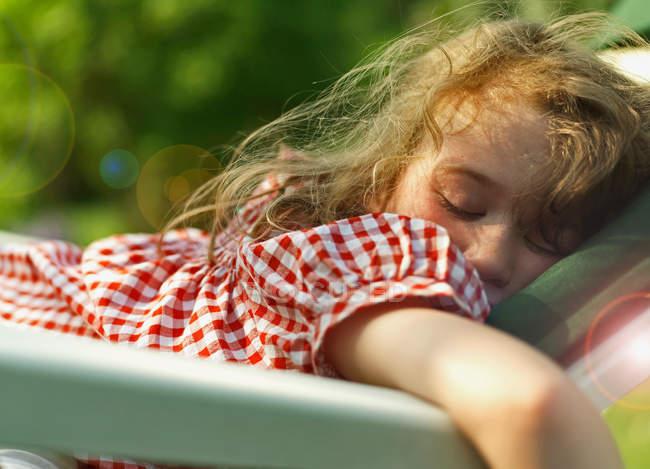 Portrait of Girl sleeping outdoors — Stock Photo