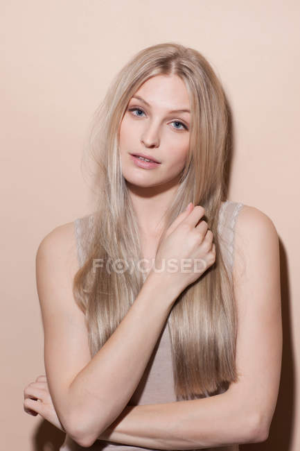 Portrait of young blonde woman, studio shot — Stock Photo