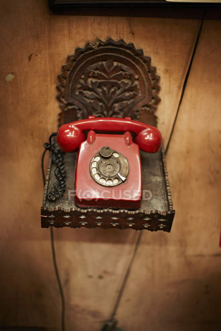 Telephone on ornate platform — Stock Photo