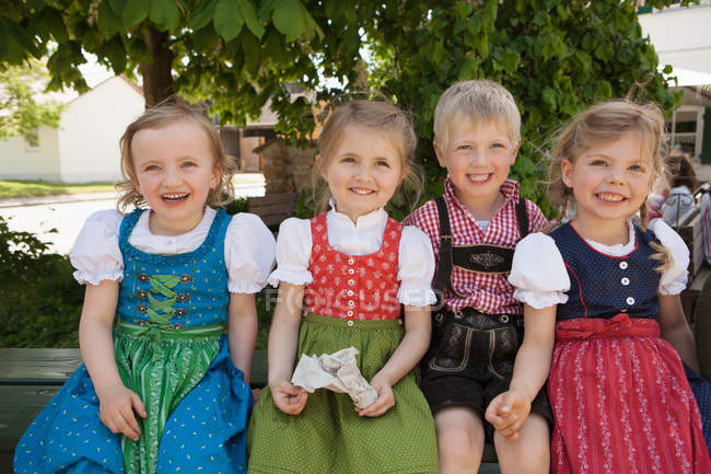 Children in traditional Bavarian clothes — стокове фото