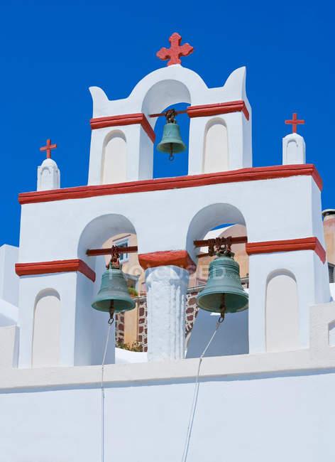 Дзвони церковні, ія, Санторіні, Греція — стокове фото