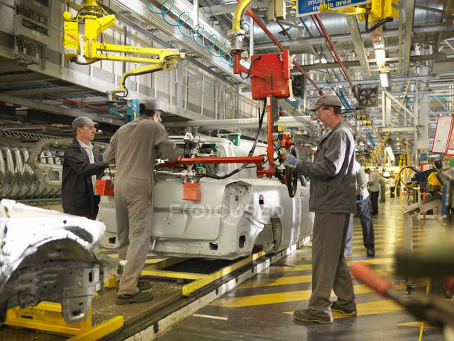 Car Plant Workers On Production Line — Stock Photo