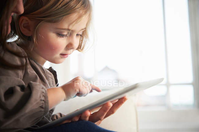 Close up of mother and daughter using digital tablet — Stock Photo
