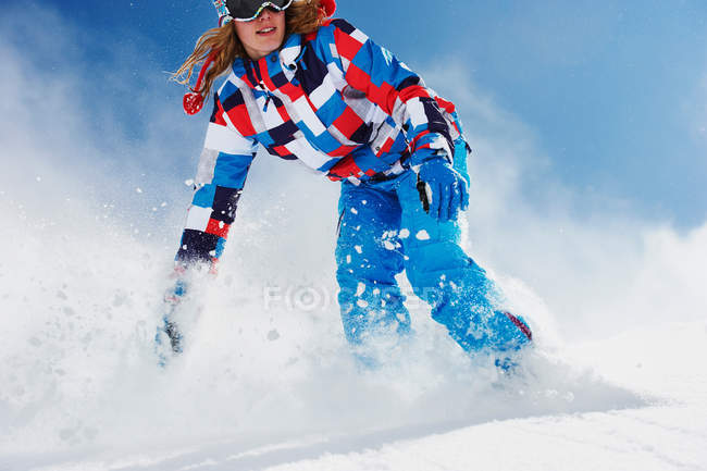 Female snowboarder in action — Stock Photo