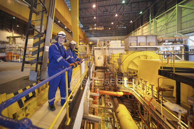 Portrait of workers in turbine hall of power station — Stock Photo
