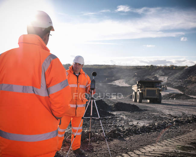 Ecologists monitoring sound in surface coal mine — Stock Photo