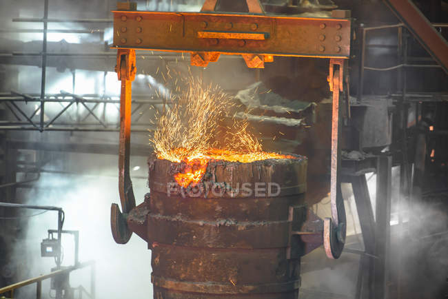 Close up of ladle full of molten metal in industrial foundry — Stock Photo