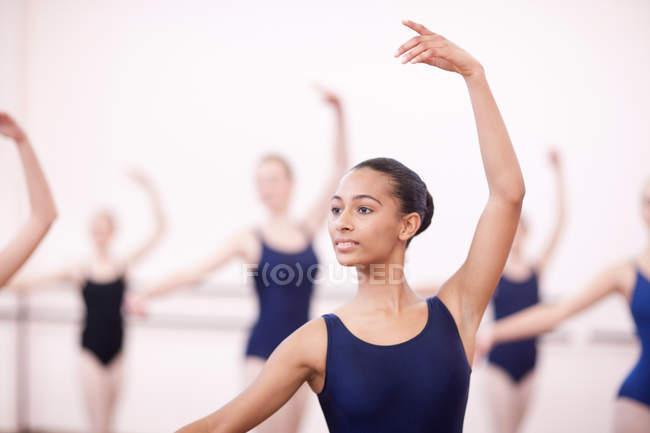 Group of synchronized teenage ballerinas — Stock Photo