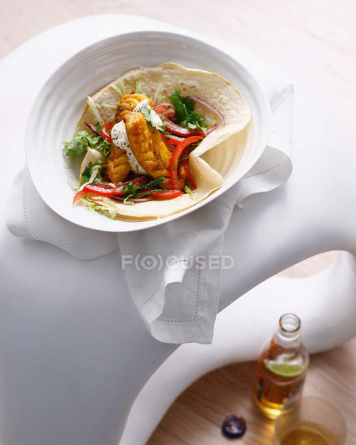 Fish taco with bottle of beer — Stock Photo