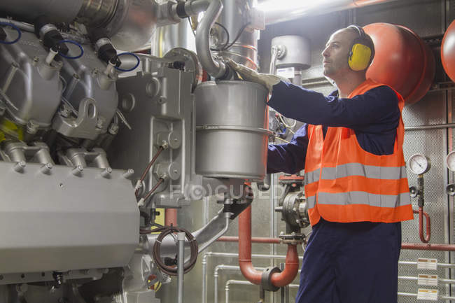 Technician making a check in power station — Stock Photo