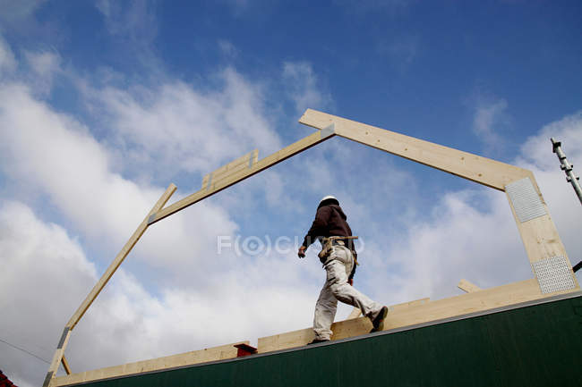 Builder walking on new structure — Stock Photo