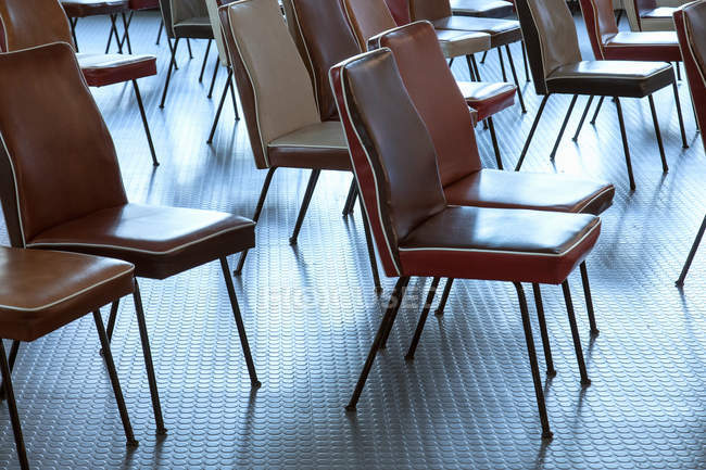 Empty brown chairs on floor indoors — Stock Photo