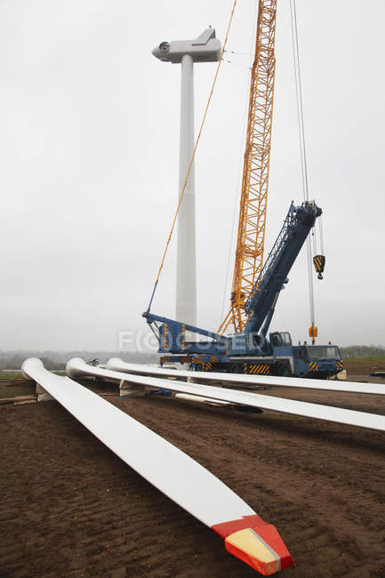 Wind turbine being accuracy erected with construction crane — Stock Photo