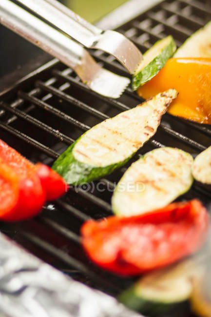 Vegetables cooking on grill — Stock Photo