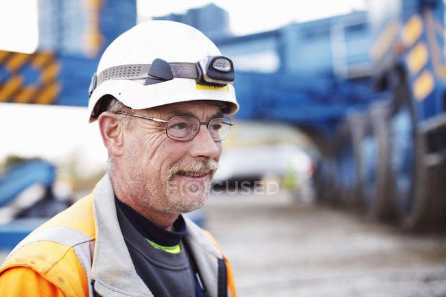 Portrait of mature engineer at wind farm construction site — Stock Photo