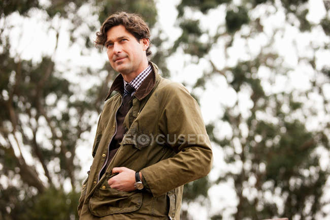 Man in countryside looking away — Stock Photo