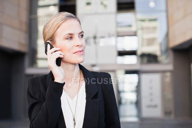 Portrait of businesswoman talking on smartphone — Stock Photo