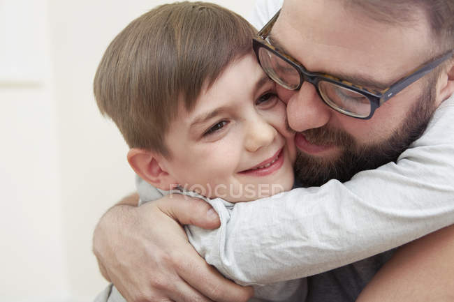 Mid adult man and son hugging each other — Stock Photo