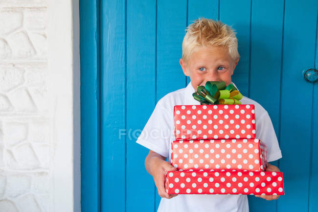 Boy excited holding gifts — Stock Photo