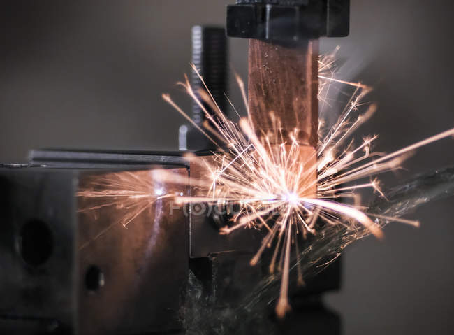 Spark from wire erosion machine in factory — Stock Photo