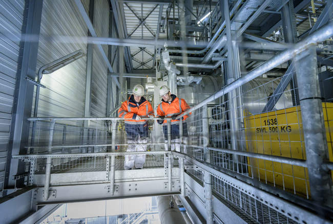 Workers on high level walkway in gas-fired power station — Stock Photo