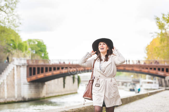 Stylish young woman strolling on riverside, Paris, France — Stock Photo