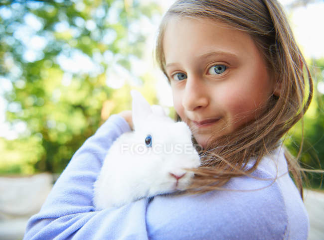 Close up of girl holding pet rabbit — стоковое фото