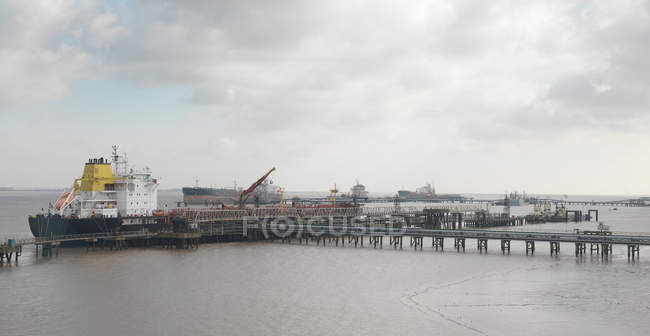 Ships Docked At A Port under cloudy sky — Stock Photo