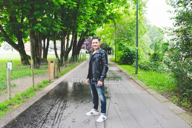 Stylish happy man posing in park — Stock Photo