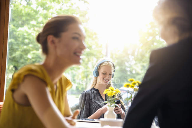Small group of people sitting inside cafe — Stock Photo