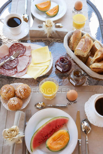 Top view of table laid with breakfast — Stock Photo