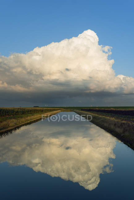 Scenic view of clouds reflecting in river, netherlands — Stock Photo