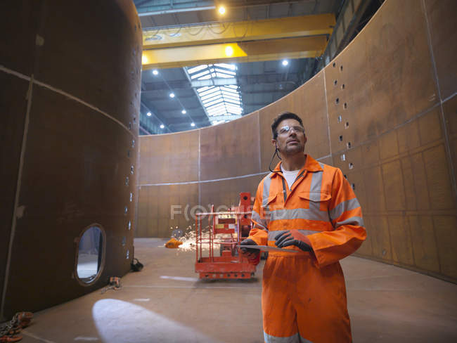 Engineer inspecting marine fabrication used for cable laying — Stock Photo
