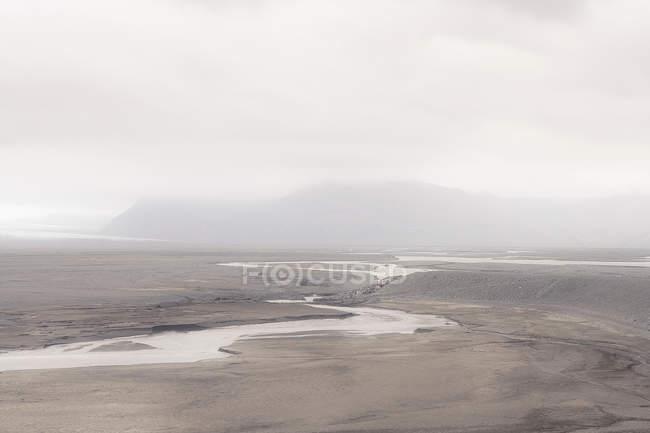Stream in misty landscape — Stock Photo