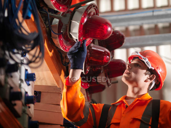 Crane Worker Checking Safety Lights — Stock Photo