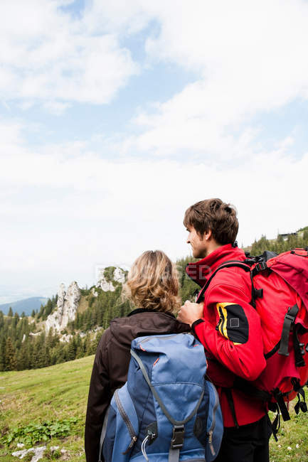 Couple watching countryside at mountains — Stock Photo