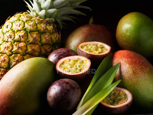 Tropical fruits nestled together — Stock Photo