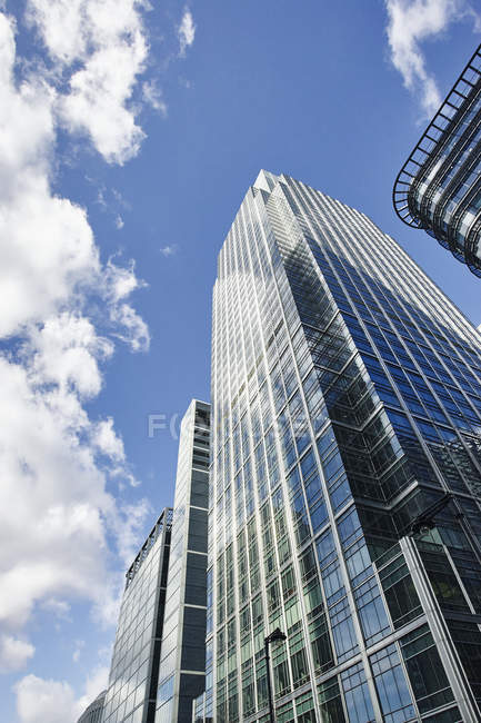 Low angle view of skyscrapers and blue sky, Canary Wharf, London, UK — Stock Photo