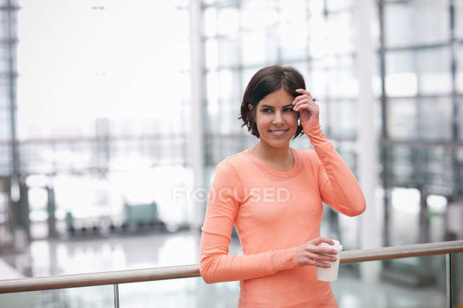 Candid portrait of young female with coffee — Stock Photo