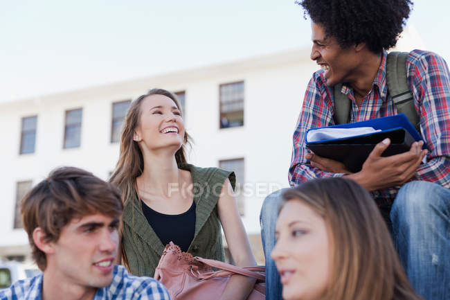 Students talking on campus, focus on foreground — Stock Photo